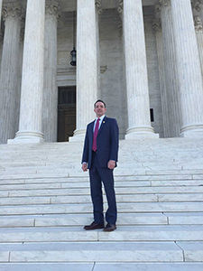Stephen J. Brown on the steps of the Supreme Court