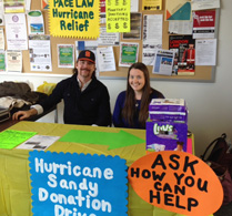 Pace Law students Kiera Fitzpatrick and Patrick Van Hall working Hurricane Sandy Relief table