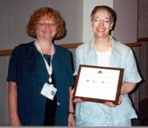 Marie Newman (and Alice Pidgeon) with her award for Law Library Journal article of the year at the AALL conference in Philadelphia.