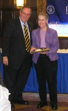 Marie Newman receiving her Outstanding Contribution Award from former Pace president David Caputo.