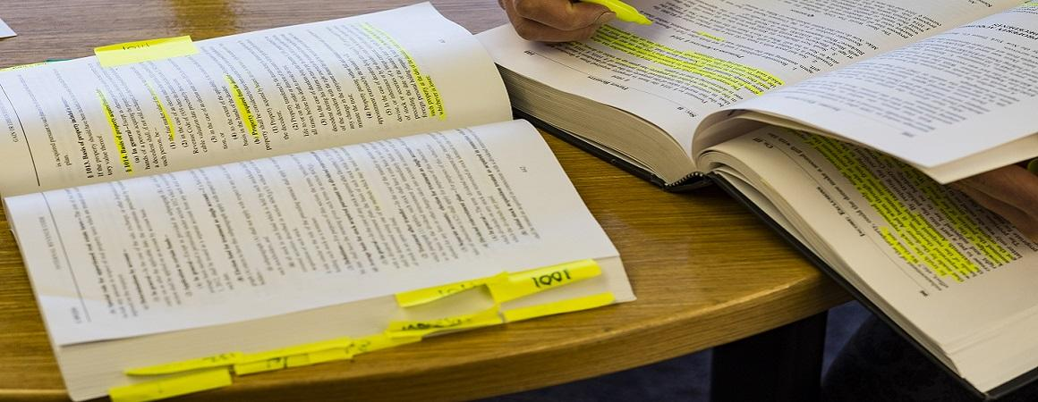 Student books with notes and highlights