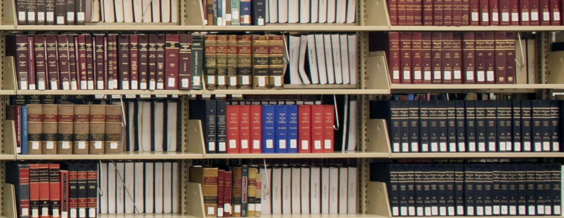 photo of law books on shelf -- James D. Hopkins Professor of Law Memorial Lecture header