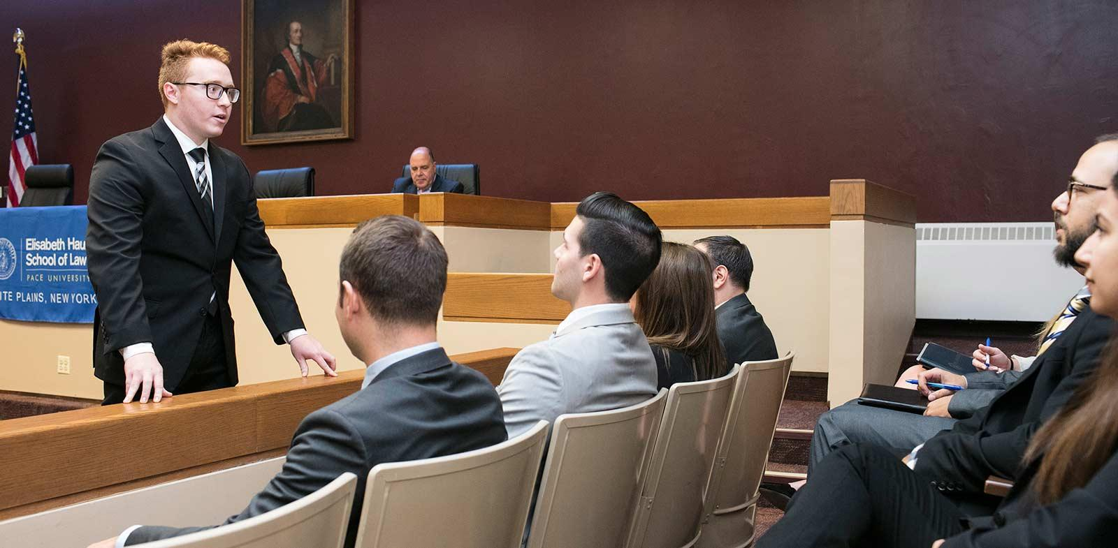 A student in a moot court competition presents to the jury